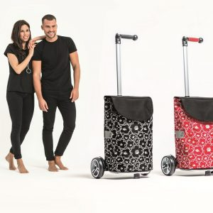 Man and women with unus shopping trolleys